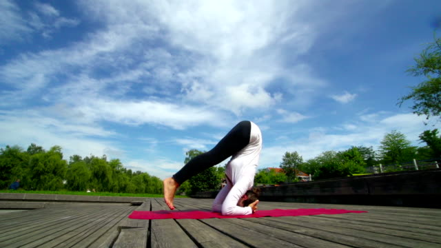 HD-MS: Beautiful Young Woman Practicing Yoga Outdoors video