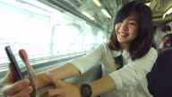 HD:Beauty asian women enjoy selfie on the train. video