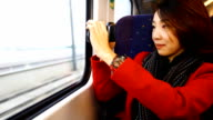 HD:Beauty asian women taking outside view on the train. video