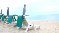 HD:Benches and umbrellas on the beach.g video