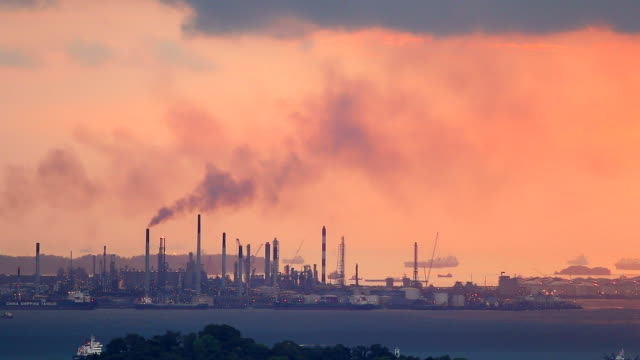 HD:Black smoke pollution from industrial area silhouette at sunset. video