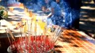HD:Burning incense and praying at a Buddhist temple in Bangkok. video