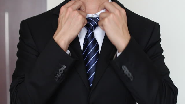 HD:Businessman correcting a tie. video