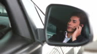 HD:Businessman driving talking on mobile phone video