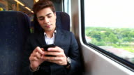 HD:Businessman playing mobile phone on the train. video