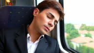 HD:Businessman relaxing on train. video