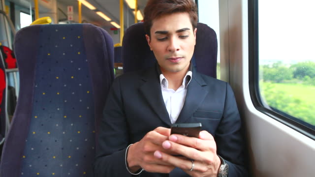 HD:Businessman using mobile phone on train video
