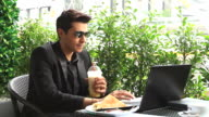HD:Businessman working at coffee shop. video