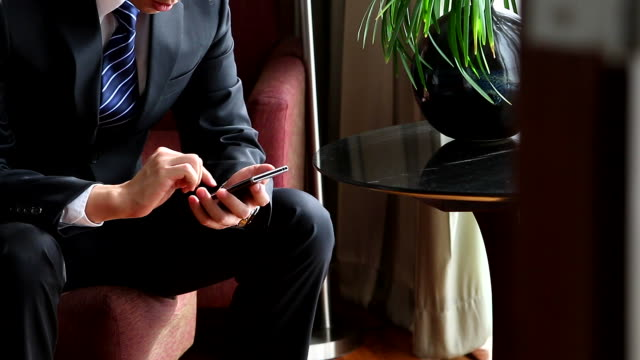 HD:Businessman working by using mobile phone. video