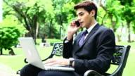 HD:Businessman working outdoor. video
