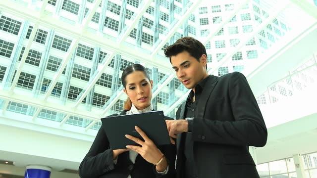 HD:Businesspeople having informal meeting outdoor. video