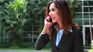 HD:Businesswoman using mobile phone. video