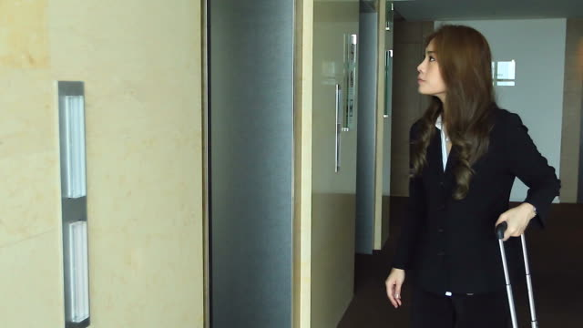 HD:Businesswoman waiting in front of an elevator. video