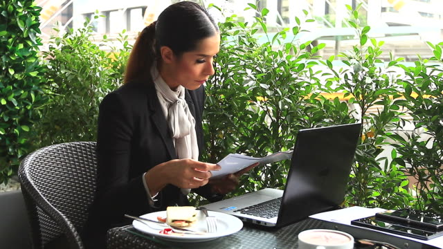 HD:Businesswoman working and eating breakfast outdoor. video