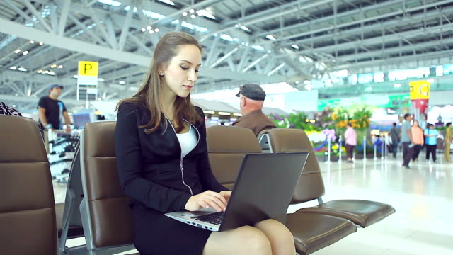HD:Businesswoman working by using laptop at airport. video