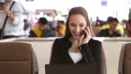 HD:Businesswoman working by using mobile phone at airport. video