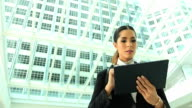 HD:Businesswoman working with tablet outdoor. video