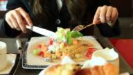 HD:Businesswomen eating dessert in a restaurant. video