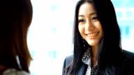 HD:Businesswomen presenting her idea to customer.. video