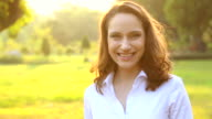 HD:Close up portrait of an woman smiling outdoors. video