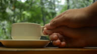 HD:Coffee in the nature with hand for relax time video