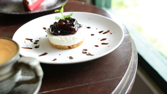 HD:Coffee with dessert blueberry cheese pie video