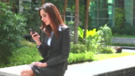HD:Confident young businesswoman playing mobile phone. video
