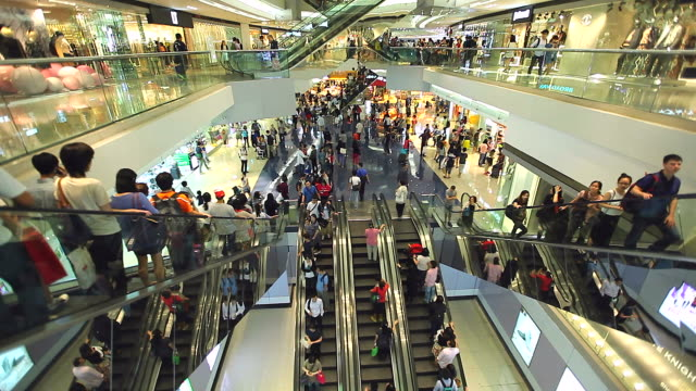 HD:Crowed people moving on escalator in shopping mall. video
