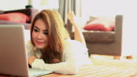HD:Cute asian female playing notebook.(Dolly shot) video