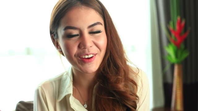 HD:Cute asian female talking to webcam. video