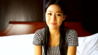 HD:Cute asian female talking to webcam. video