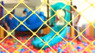 HD:Family at indoor playground.(Selective focus on the net) video
