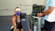 HD:female Athlete Doing ECG and VO2 test on Rowing Machine video