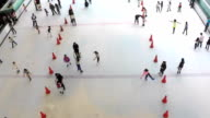 HD:Group of people Ice Skating on indoor Ice Rink.(Time lapse) video