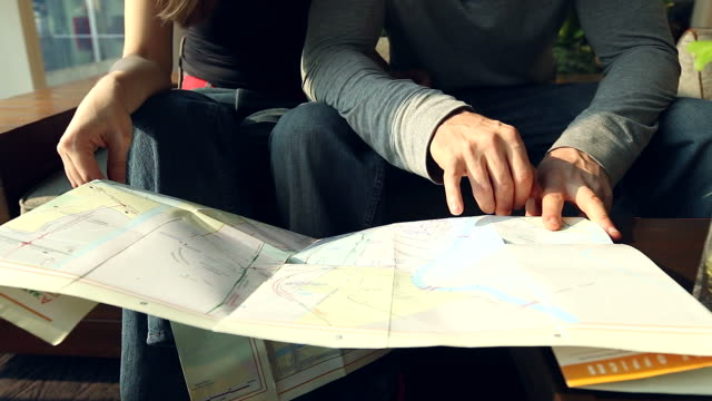 HD:Hand of tourist couple checking city map. video