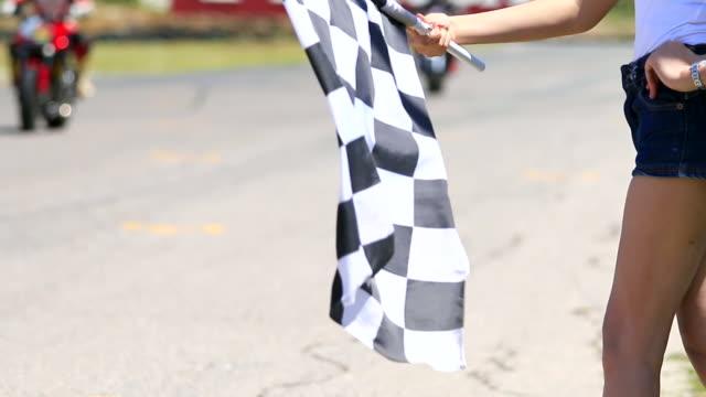 HD:Hand of woman waving race flag. video