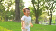 HD:Happy little boy running at the park with sunset (Slow motion) background. video