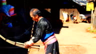 HD:Karen man in traditional costumes playing a flute. video