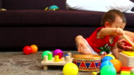 HD:Little boy is playing with toy. video