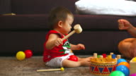 HD:Little boy playing toy with his mom. video
