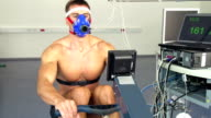 HD:Male Athlete Performing ECG and VO2 test on Rowing Simulator video