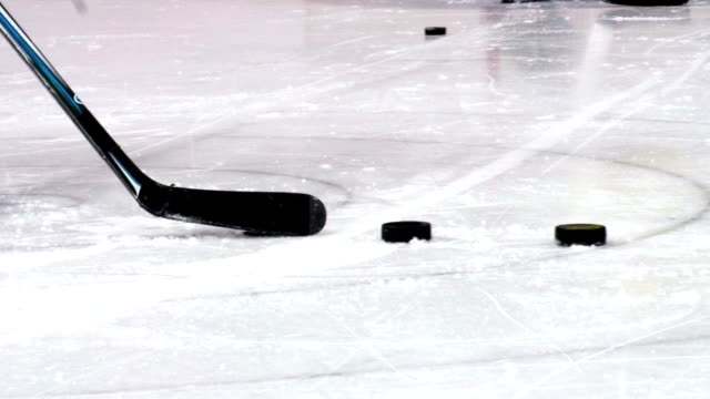 HD:M.S.Shot of Hockey Player Shooting at Goal video