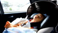 HD:Portrait of little baby sitting in safety carseat. video