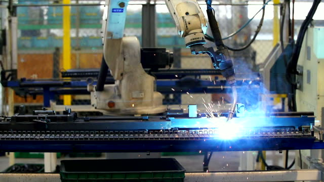 HD:Robot arm welding in a factory.(Slow motion) video