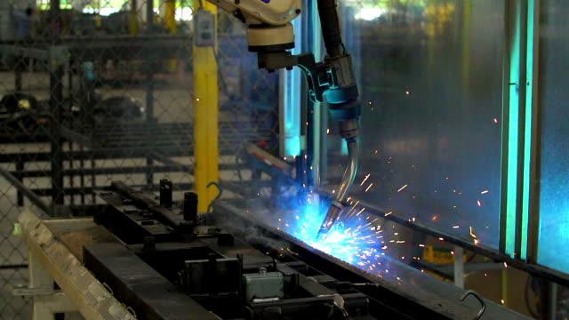 HD:Robot arm welding machine working in factories. video