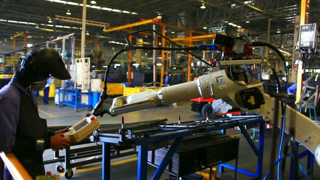 HD:Robotic arm welding during instrument process. video
