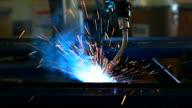 HD:Robotic arm welding in factory.(Panning) video