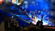 HD:robotic arm welding in factory. video