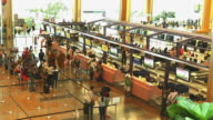HD:Row of people check in at the airport. video