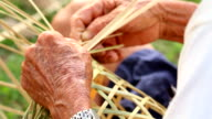 HD:Senior hands manually weaving bamboo basket. video
